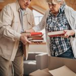 two senior citizens packing for a move
